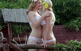 Two lovely girl in white stockings trahayutsya with one man