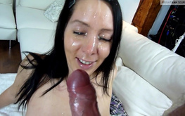 Gorgeous blue-eyed amateur is sucking a tasty wiener on the couch